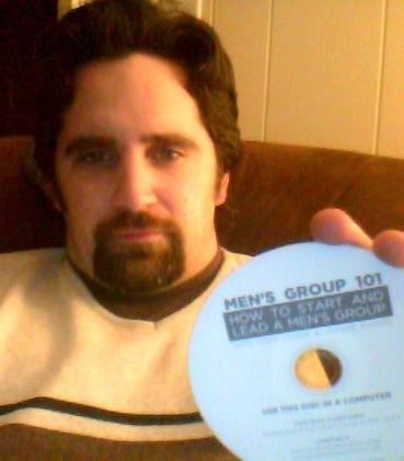 Daryl holding the Mens Group 101 DVD
